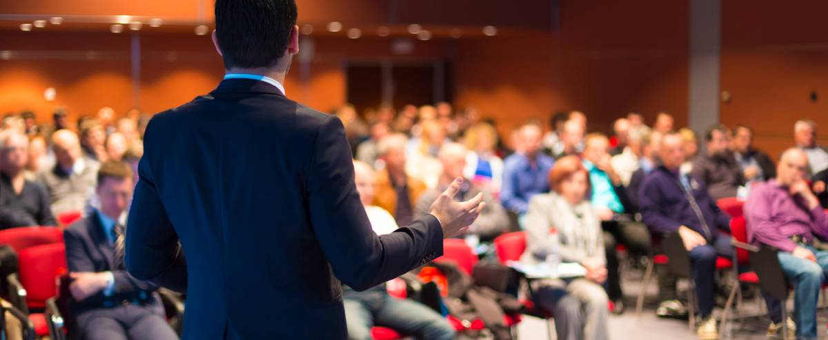 man taking seminar